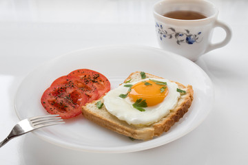 Tasty breakfast with fried egg on white background.