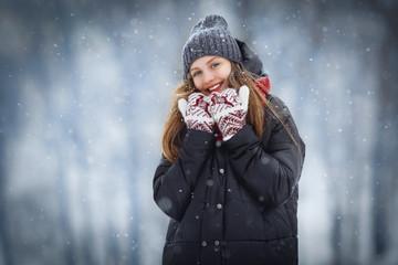 Winter young woman portrait. Beauty Joyful Model Girl laughing and having fun in winter park. Beautiful young female outdoors, Enjoying nature, wintertime