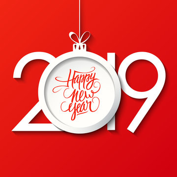 2019 Happy New Year celebrate card with handwritten New Year holiday greetings and christmas ball on red background. Vector illustration.