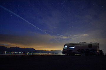An RV parked at the shores of the Salton Sea, CA at twilight