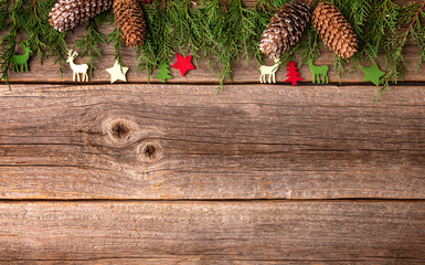 Composition from festive objects of New Year and Christmas on a wooden background.