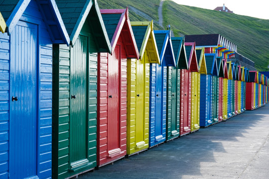 f brightly painted beach huts at Whitby on the Yorkshire coast