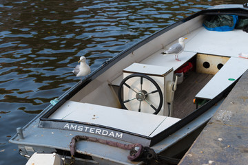 small motor boat in the amsterdam canals