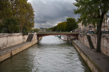 The view from the banks of the Seine River in Paris, France on a cloudy day.