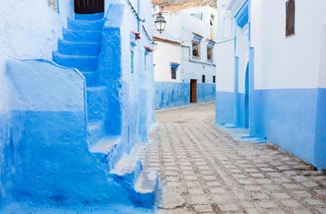alone silent street in blue city Chefchaouen in Morocco