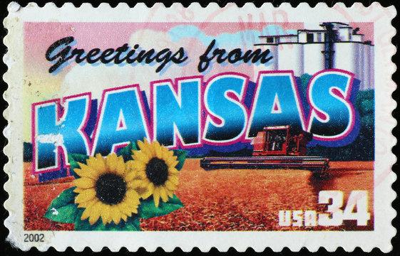 Greetings from Kansas postcard on stamp