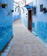 street with door and flowers in blue city Chefchaouen in Morocco