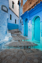 Deurstickers walls and doors on the old street in blue city Chefchaouen in Morocco