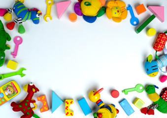 Baby toys frame. Colorful kids toys on white background. Copy space for text. Top view. Flat lay.