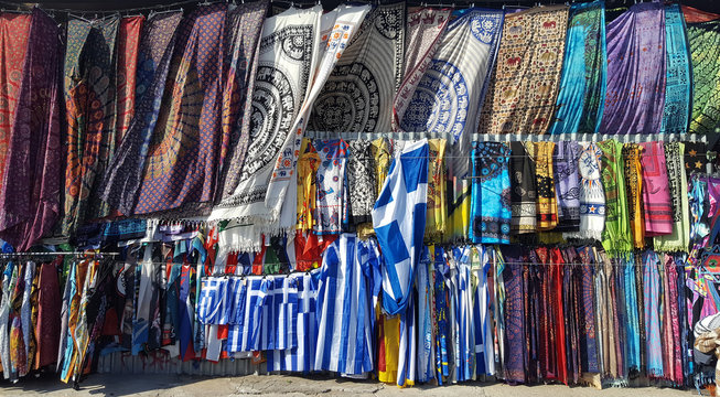 Multicolored textile of scarf and pareo and flags for sale on the Monastiraki flea market in Athens, Greece