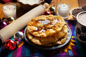 Mexican buñuelos with piloncillo syrup