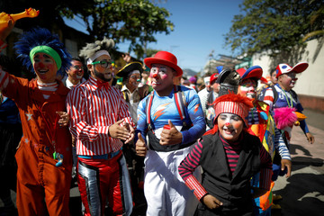 Salvadorean clowns participate in a parade during Salvadoran Clown Day celebrations in Santa Tecla