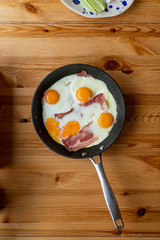 Sunny Side Up Eggs with Bacon, in a pan