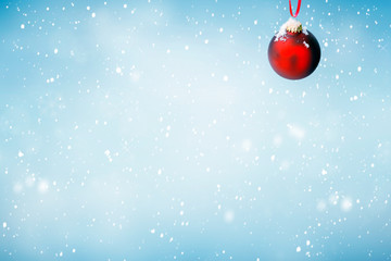 Christmas background with red ornament and falling snow
