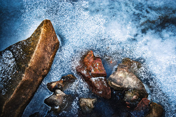 stones frozen in ice on the river