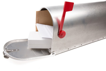 perspective view of an open old school retro tin mailbox bulging with a pile of letters and box parcel on white isolated background