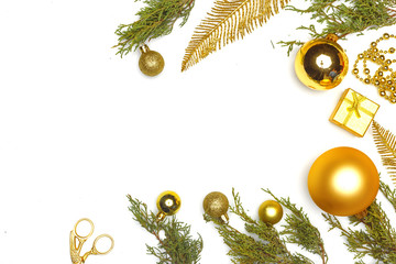 Christmas composition. Gold elements of Christmas decor, decorations, sweets and fir branches on a white background.