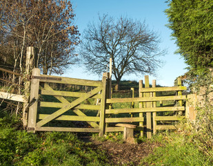 Countryside wooden path stile and gate