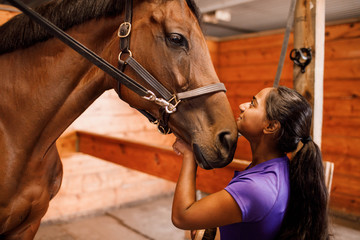 Girl Looking at Horse in Cross Ties