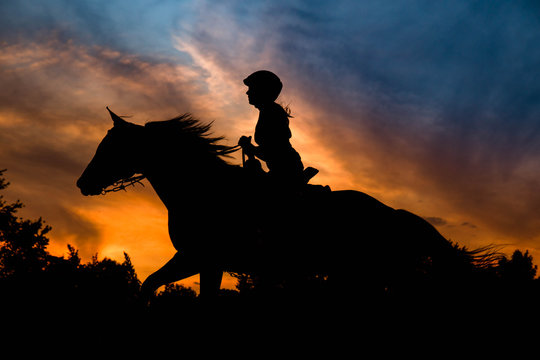 Girl Riding in Silhouette