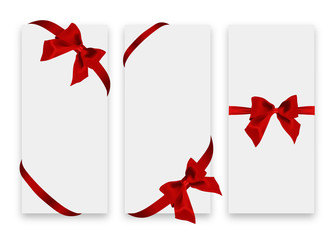 Gift card. White gift voucher templates with red ribbon and a bow.