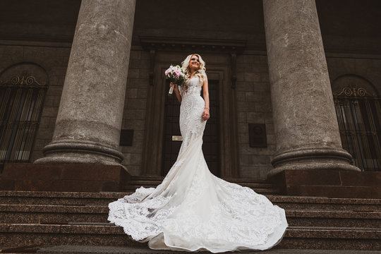The bride in a long dress near the mansion