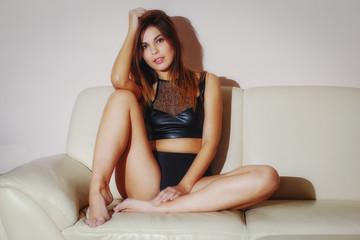 A pretty brunette woman posing in lingerie