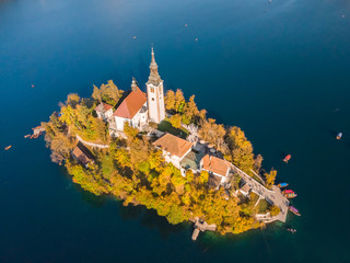 Aerial view of island of lake Bled with Pilgrimage Church of the Assumption of Maria in city of Bled in Slovenia.