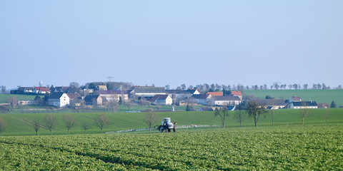 Farm implements: Self propelled field crop sprayer on a freshly sown field in Eastern Thuringia in April