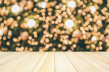 Wood table top with abstract christmas holiday festive bokeh light on tree blurred background for montage product display