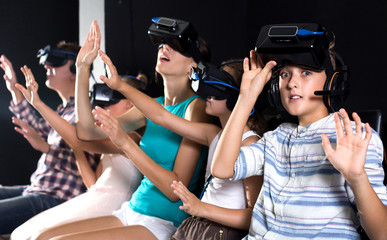 Boy is fascinated by movie in virtual reality glasses
