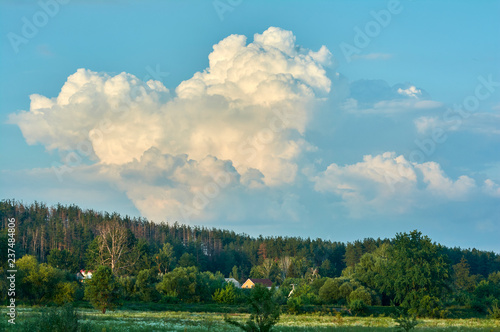 Summer landscape in the evening  The sky with huge