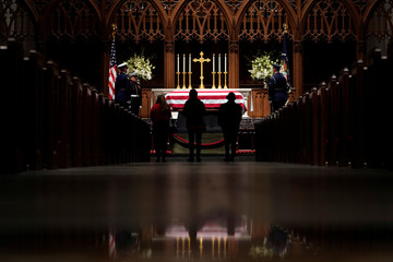People pay their respects as former President George H.W. Bush lies in repose at St. Martin's Episcopal Church Wednesday, Dec. 5, 2018, in Houston