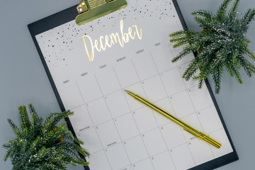 Top view calendar, month of December with tiny holiday trees