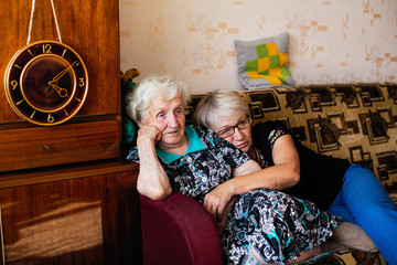 Elderly woman in his home with adult daughter.