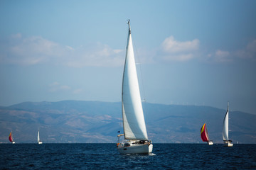 Sailing boats participate in sail yacht regatta in Aegean Sea, Greece.