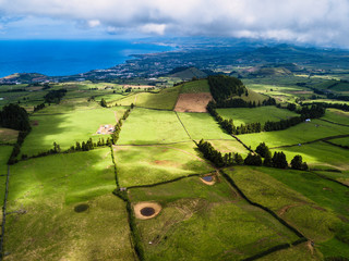 Aerial view of green fields of San Miguel island and coastline of Atlantica, Azores, Portugal.