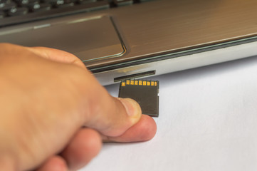 Inserting memory card flash drive into a computer laptop