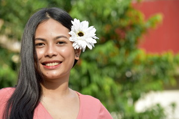 Beautiful Filipina Woman And Happiness With Flowers