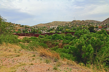 Border Fence beside a road near Nogales, Arizona separating the United States from Mexico.