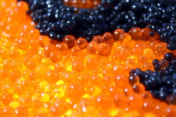 Texture red and black caviar photographed close up