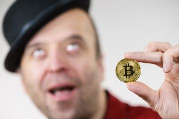Man having bitcoin coin