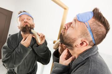 Man shaving trimming his beard