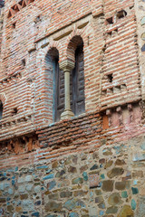 CACERES, SPAIN - NOVEMBER 25, 2018: window with mullion on a brick wall