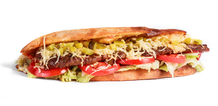 Sandwich from fresh pita bread with fillet grilled beef, lettuce, slices of fresh tomatoes, pickles and cheese on white background