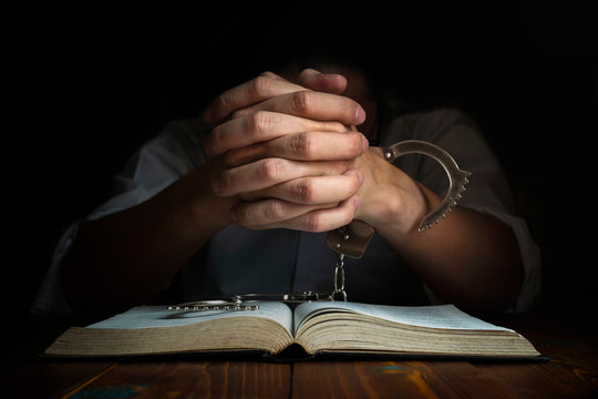 Handcuffs and the Holy Bible. Concept Picture of Someone Who Released From Sin by the God Words