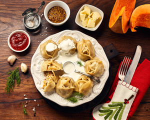 Asian steamed homemade dumplings Manti with pumpkin and garlic. Christmas or New Year dish. Top view.