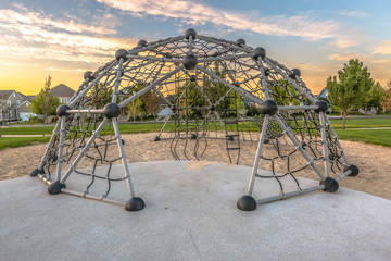 Dome climbing frame with rope ladder in the center