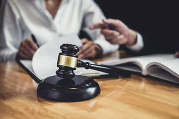 Male lawyer or Counselor working in courtroom have meeting with client are consultation with contract papers of real estate, Law and Legal services concept