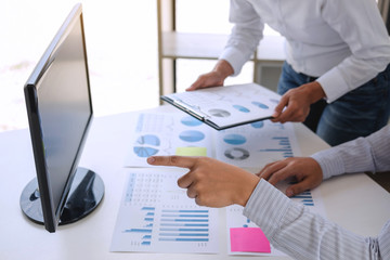 Business accountant or banker, business partner calculate and analysis with stock financial indices and financial costs wisely and carefully, investment and finance concept